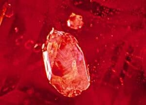 Ruby Treatment Image - Unheated Ruby - Another intact and unaltered calcite crystal and hexagonal color zoning seen within